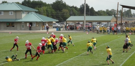 Junior Football League players during game on a football field in Mattoon IL